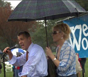 Keeping Maryland State Senator Roger Manno as dry as possible during his awesome speech.